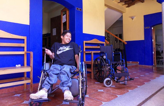 Smiling young man in wheel chair