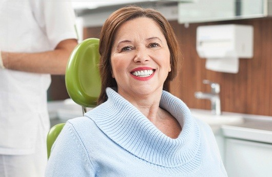 Woman with denture smile in dental chair